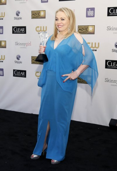 Actress Jacki Weaver poses backstage with the best acting ensemble award she won as being a part of the cast in Silver Linings Playbook at the 2013 Critics Choice Awards in Santa Monica