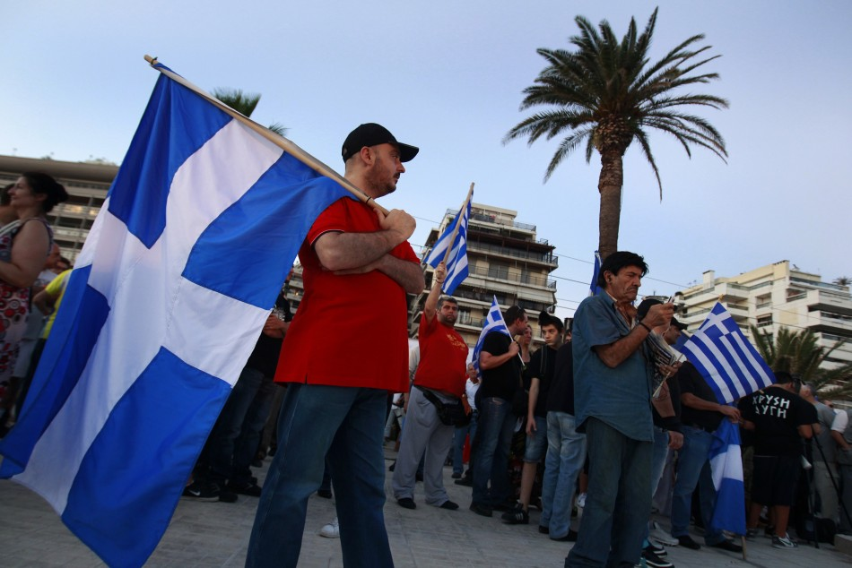 Supporters of the extreme right Golden Dawn party hold Greek flags