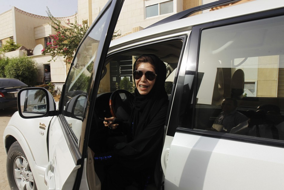 Female driver Azza Al Shmasani alights from her car after driving in defiance of the ban in Riyadh (Reuters)