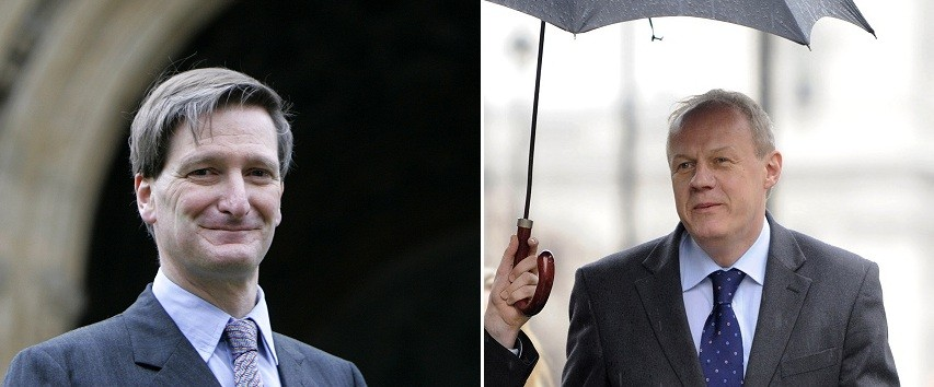 Grieve (l) Green keeps out of the wet beneath umbrella