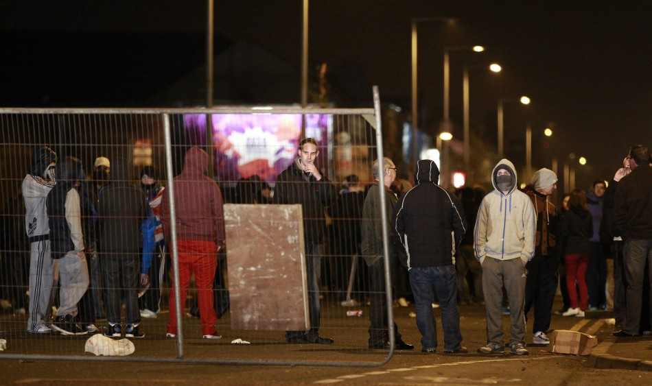 Youths place barricades across the Newtownards Road in Belfast during ongoing Union Flag protests in the city (Reuters)