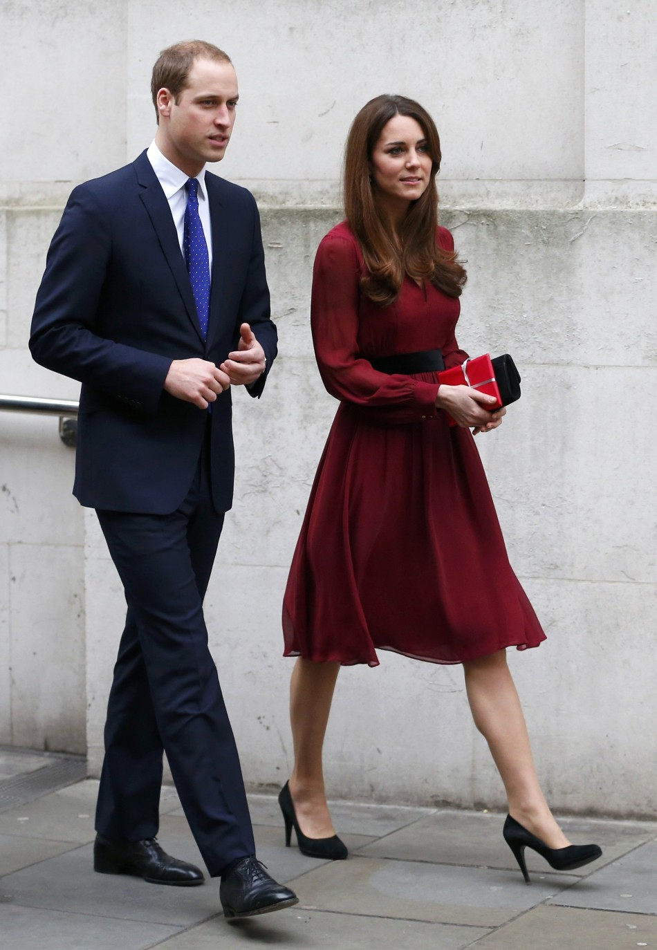 Catherine, Duchess of Cambridge, leaves the National Portrait Gallery with her husband, Prince William
