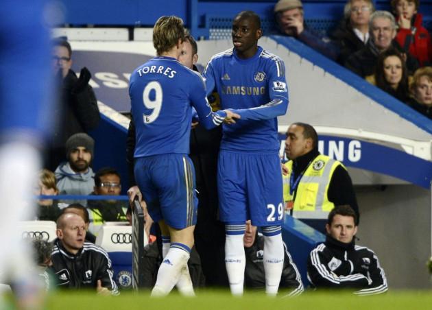 Demba Ba (L) and Fernando Torres
