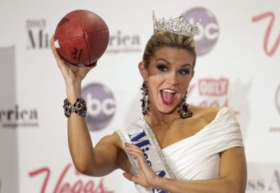 Miss America 2013 Mallory Hytes Hagan, Miss New York, poses with a football during a news conference in Las Vegas