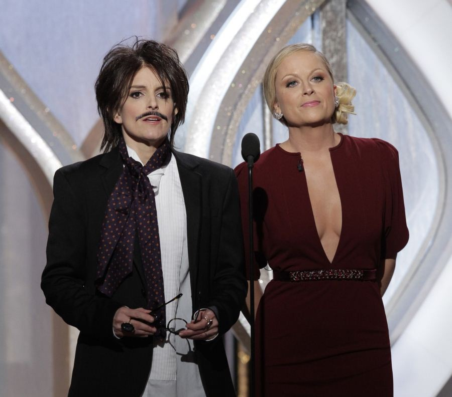 Hosts Tina Fey (L) and Amy Poehler on stage at the 70th annual Golden Globe Awards in Beverly Hills