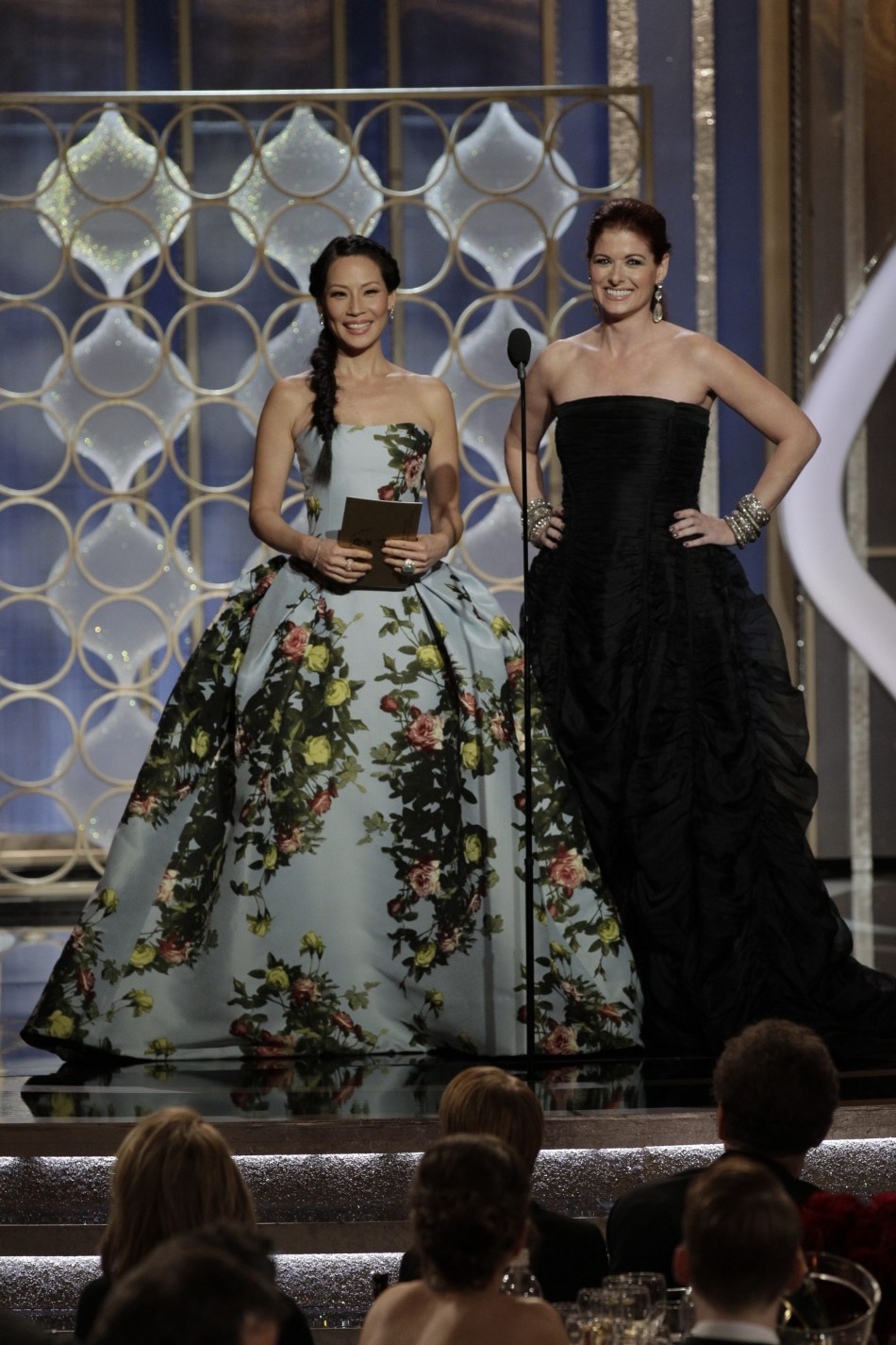 Presenters Lucy Liu (L) and Debra Messing at the Golden Globe Awards in Beverly Hills