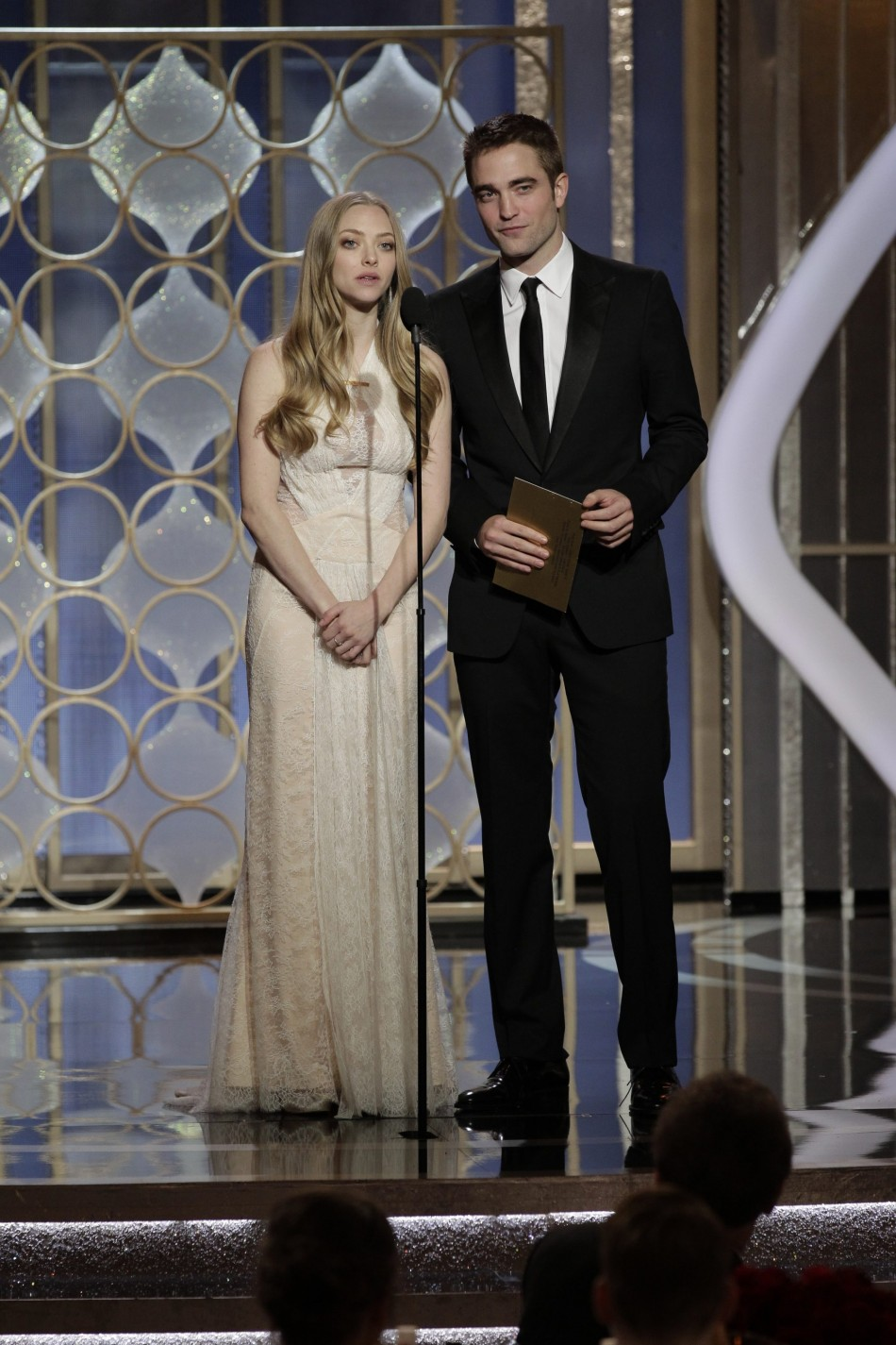 Presenters Amanda Seyfried and Robert Pattinson on stage at the Golden Globe Awards in Beverly Hills