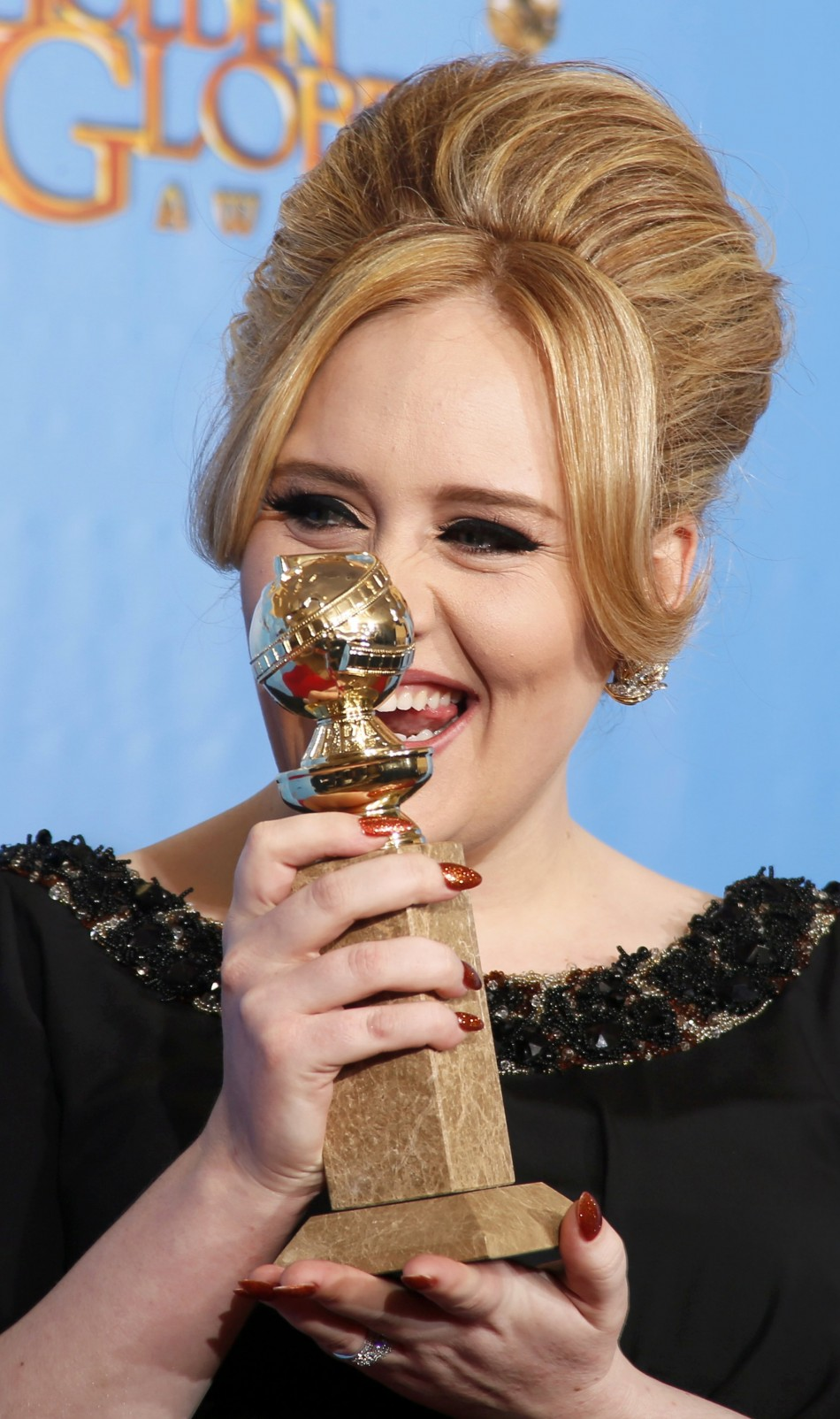 Adele, winner for Best Original Song - Motion Picture, for Skyfall from the film of the same name poses with her award at the 70th annual Golden Globe Awards in Beverly Hills