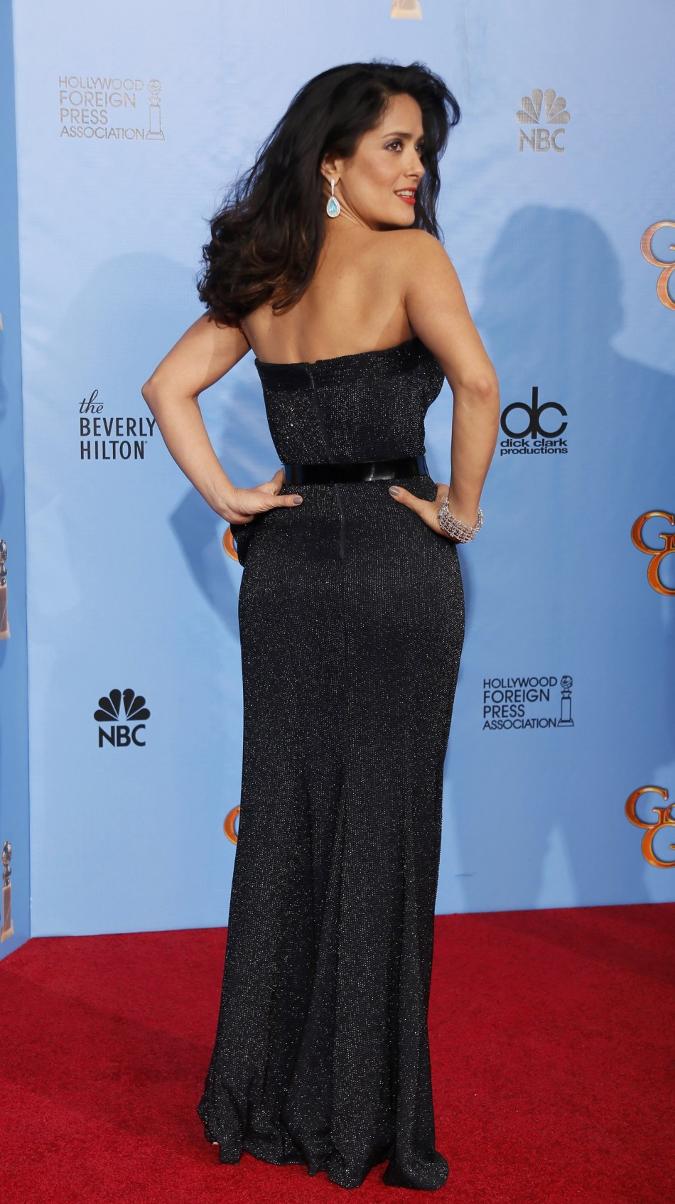 Actress Salma Hayek poses backstage after presenting an award at the 70th annual Golden Globe Awards in Beverly Hills
