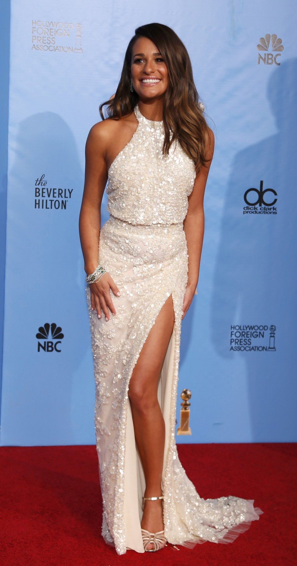 Presenter Lea Michell poses backstage at the 70th annual Golden Globe Awards in Beverly Hills