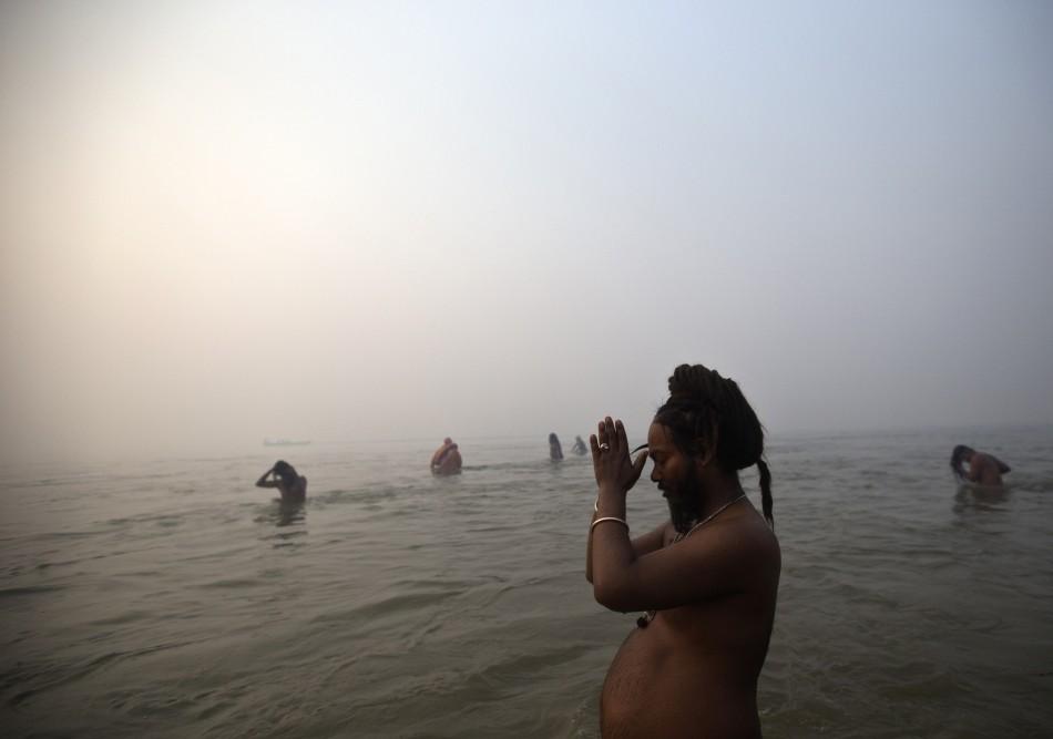 Sadhu or Hindu holy man prays as he takes dip during first Shahi Snan at ongoing Kumbh Mela, in northern Indian city of Allahabad