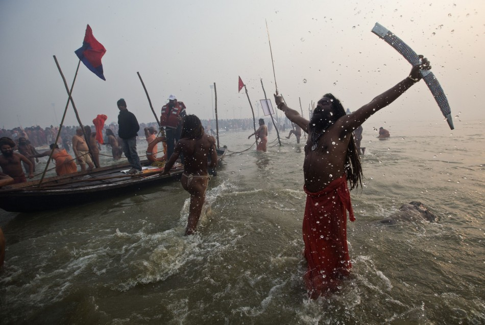 Hindu holy brandishes sword as he attends first Shahi Snan at ongoing Kumbh Mela, or Pitcher Festival, in northern Indian city of Allahabad