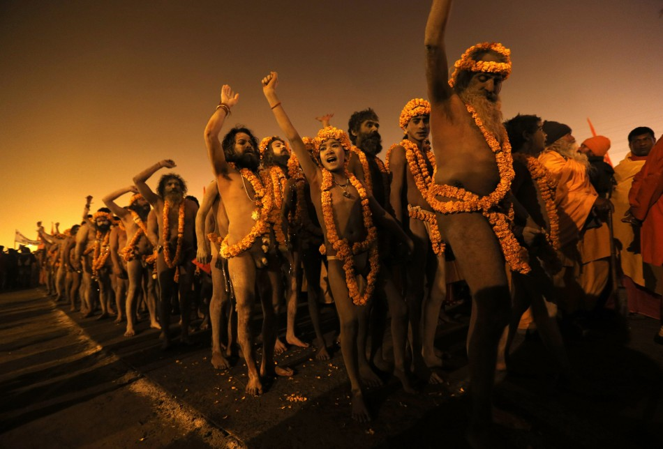 Naga sadhus or Hindu holymen arrive to attend the first Shahi Snan at the ongoing Kumbh Mela, or Pitcher Festival, in Allahabad