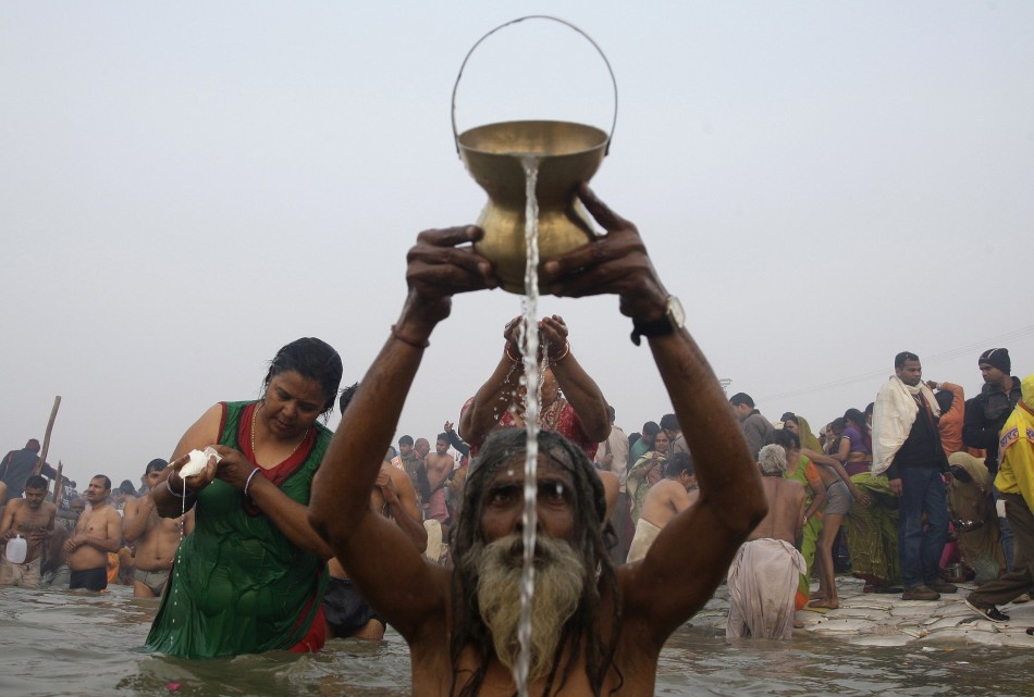 Hindu devotees pray as they attend the first Shahi Snan at the ongoing Kumbh Mela, or Pitcher Festival, in Allahabad