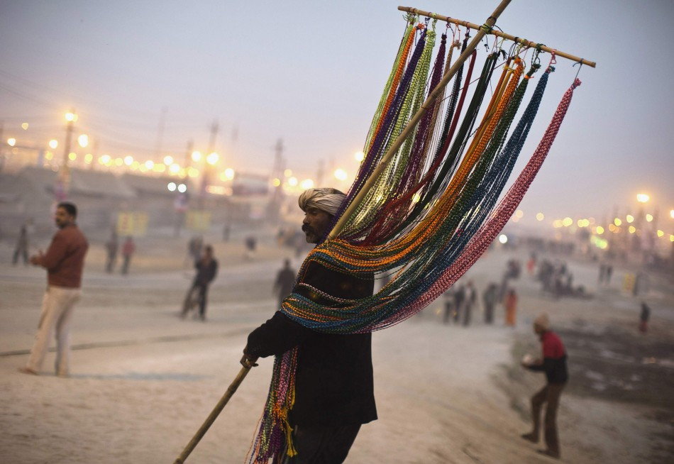 A vendor sells religious beads near banks of river Ganges ahead of Kumbh Mela in of Allahabad