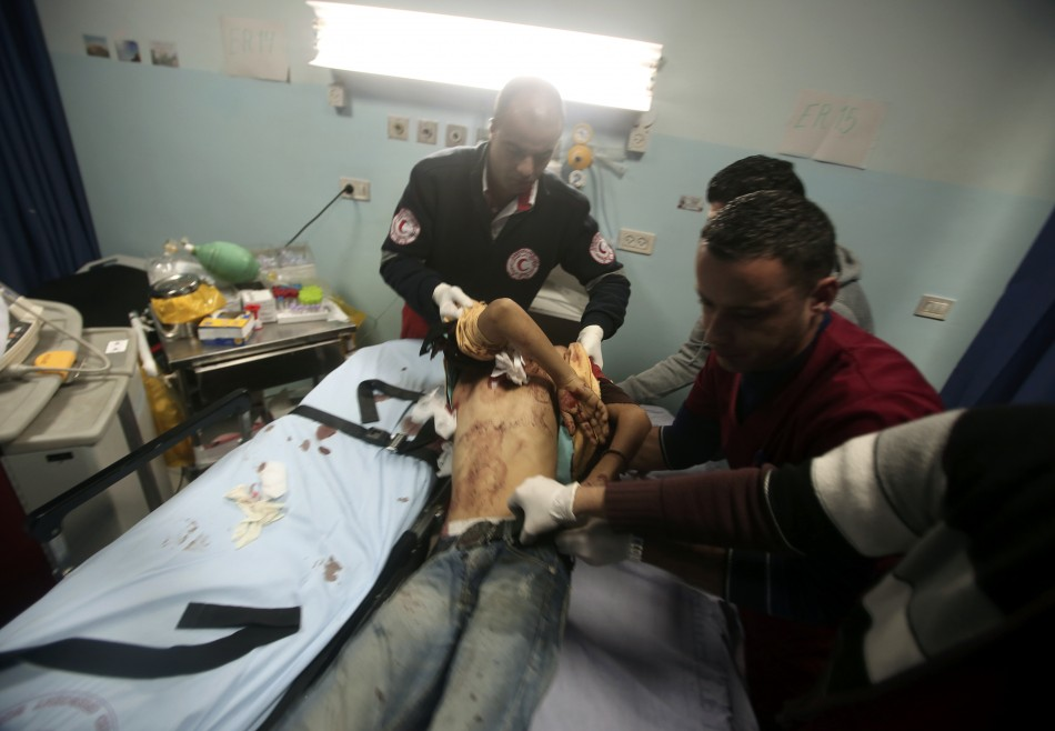 Palestinian medic lifts a Palestinian youth at a hospital in Ramallah