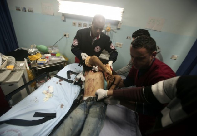 Palestinian medic lifts a Palestinian youth at a hospital in Ramallah