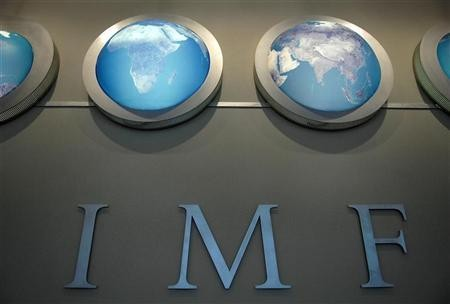 The IMF nameplate is displayed on a wall at the headquarters in Washington April 11, 2008.