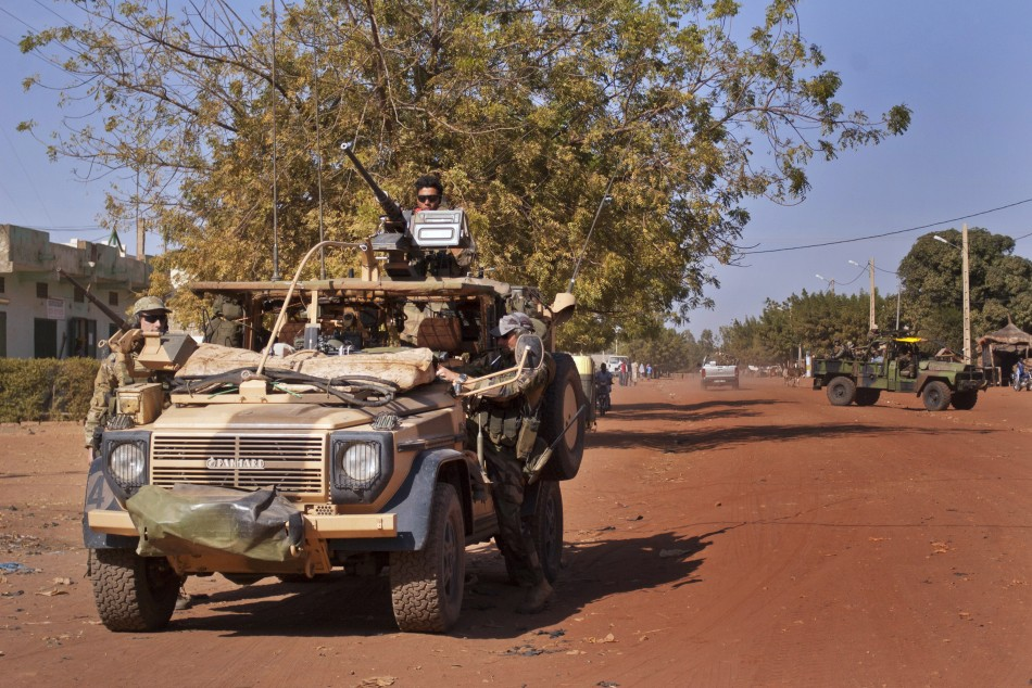 French Elite Special Operations soldiers drive through the town of Markala