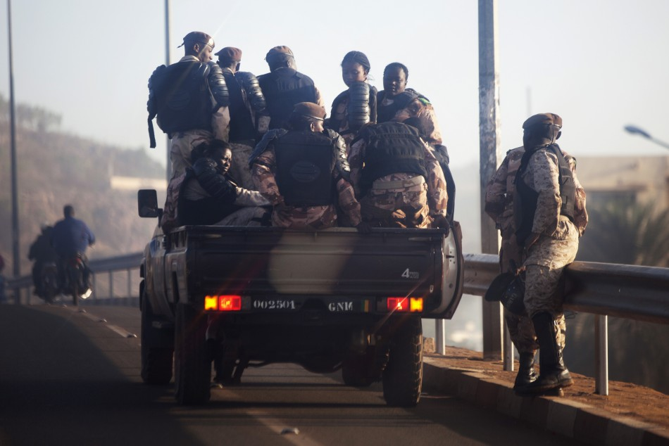 Malian soldiers drive through the streets of Bamako