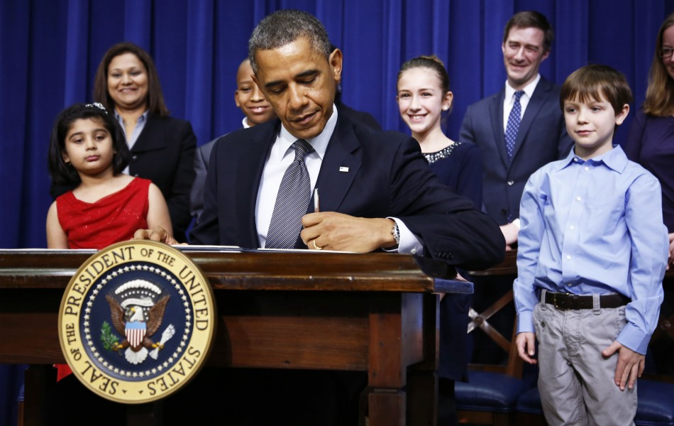 President Barack Obama signs executive orders on gun violence at the White House (Reuters)