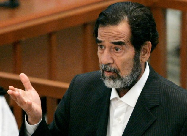 Former Iraqi leader Saddam addresses the court on the third day of his trial in Baghdad