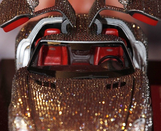 Car studded with crystals lures wealthy, but exhaust fumes kill the super-rich