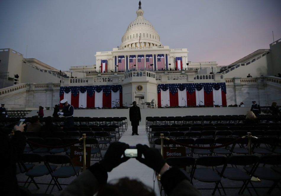 Guests at the Inauguration of the U.S. President Barack Obama take pictures before sunrise at the U.S. Capitol