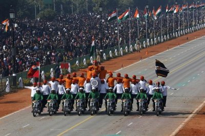 Indian Army soldiers perform a daredevil stunt during the Republic Day parade in New Delhi January 26, 2013
