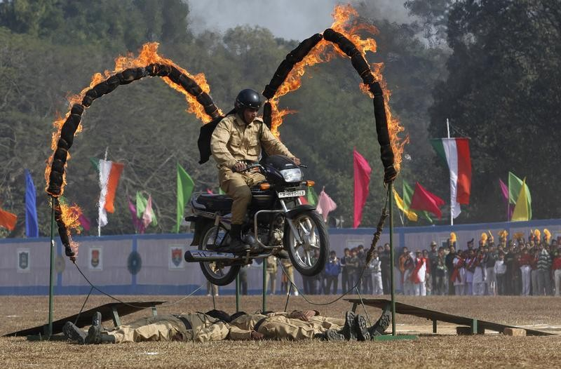 An Indian paramilitary trooper performs a stunt on his motorcycle during the Republic Day parade in Agartala, capital of northeast state Tripura, January 26, 2013.