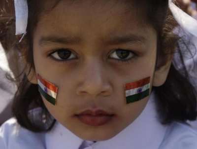 A schoolgirl with stickers of Indias national flag on her face attends a function during the Republic Day celebrations in the northern Indian city of Allahabad January 26, 2013.