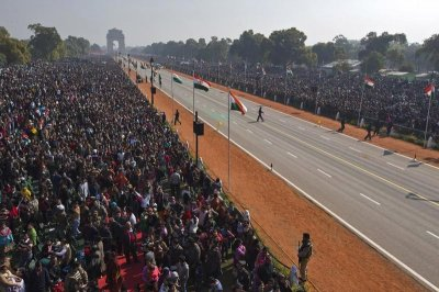 People watch the Republic Day parade in New Delhi January 26, 2013.