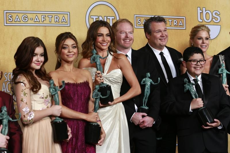The cast of Modern Family hold their awards for outstanding performance by an ensemble in a comedy series backstage at the 19th annual Screen Actors Guild Awards in Los Angeles, California