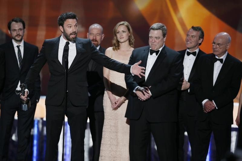 Ben Affleck 2nd from L accepts the award for outstanding cast in a motion picture for Argo at the 19th annual Screen Actors Guild Awards in Los Angeles, California