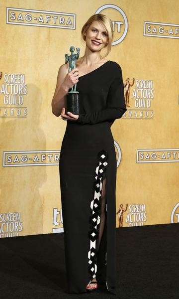 Actress Claire Danes holds the award for outstanding performance by a female actor in a drama series for her role in Homeland at the 19th annual Screen Actors Guild Awards in Los Angeles, California