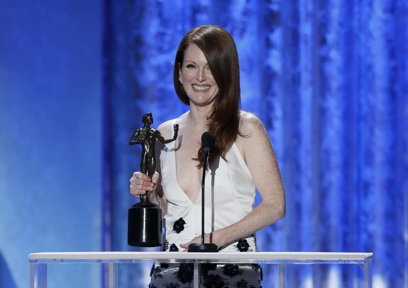 Julianne Moore accepts the award for outstanding female actor in a tv movie or miniseries for Game Change at the 19th annual Screen Actors Guild Awards in Los Angeles, California