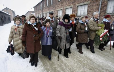 Former prisoners arrive to lay wreaths and flowers at the death wall of the Auschwitz concentration camp on January 27, 2013 during a ceremony marking the 68th anniversary of the camps liberation by Soviet troops and to remember the victims of the H
