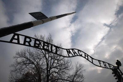 The sign Arbeit macht frei at the main gate to the Auschwitz concentration camp is seen on January 27, 2013. A ceremony to mark the 68th anniversary of the liberation of Auschwitz by Soviet troops and to remember the victims of the Holocaust w