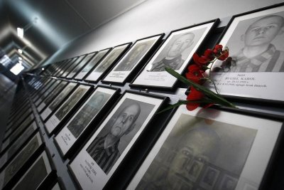 Pictures of former prisoners hang on a wall at one of the barracks at the Auschwitz concentration camp January 27, 2013. A ceremony to mark the 68th anniversary of the liberation of Auschwitz by Soviet troops and to remember the victims of the Holocaust w