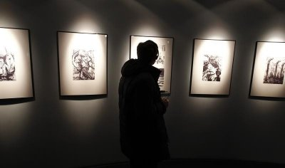 A visitor passes through a newly-opened Russian exhibition at the Auschwitz concentration camp January 27, 2013. A ceremony to mark the 68th anniversary of the liberation of Auschwitz by Soviet troops and to remember the victims of the Holocaust was held