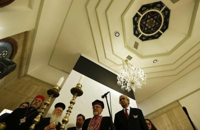 Turkeys Chief Rabbi Izak Haleva 2nd R, Syriac Orthodox Archbishop Yusuf Cetin front L, Greek Orthodox Ecumenical Patriarch Bartholomew I 2nd L and Turkish Ambassador Ertan Tezgor front R stand in remembrance of holocaust victims during a com