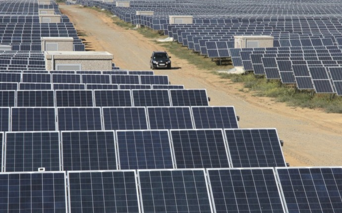 A car drives along the territory of a solar energy power station near the Okhotnikovo village in the Crimea's Saksky district