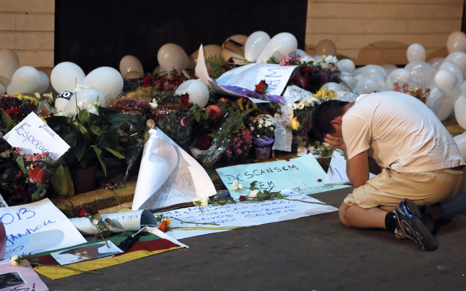 Mourner at tributes to nightclub blaze victims