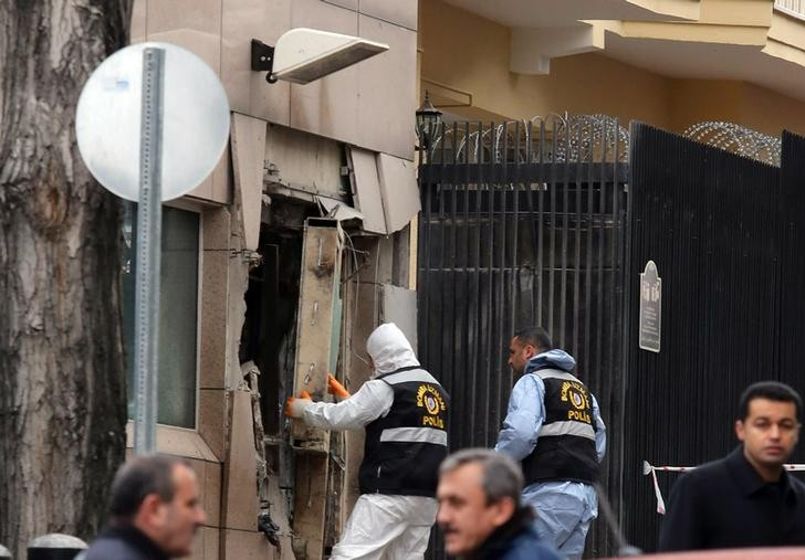 Turkish police bomb experts inspect the site of the Ankara US embassy bombing