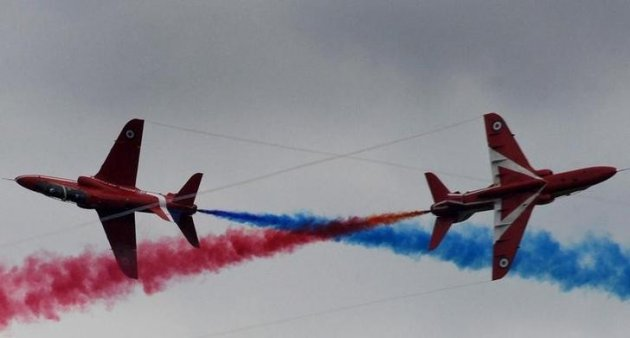 Members of the British Royal Air Force Red Arrows squadron perform a stunt (Reuters)
