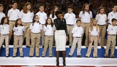 Singer Jennifer Hudson performs America the Beautiful with The Sandy Hook Elementary School Choir, from Newtown, Connecticut, prior to the NFL Super Bowl XLVII football game between the San Francisco 49ers and Baltimore Ravens in New Orleans,