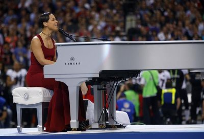Singer Alicia Keys performs the National Anthem prior to the start of NFL Super Bowl XLVII football game between the San Francisco 49ers and Baltimore Ravens in New Orleans, Louisiana