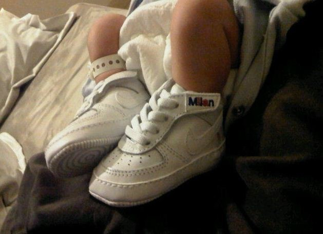 Gerard Pique shared a photo of his newborn son Milans tiny feet in white Nike sneakers, customized with his name