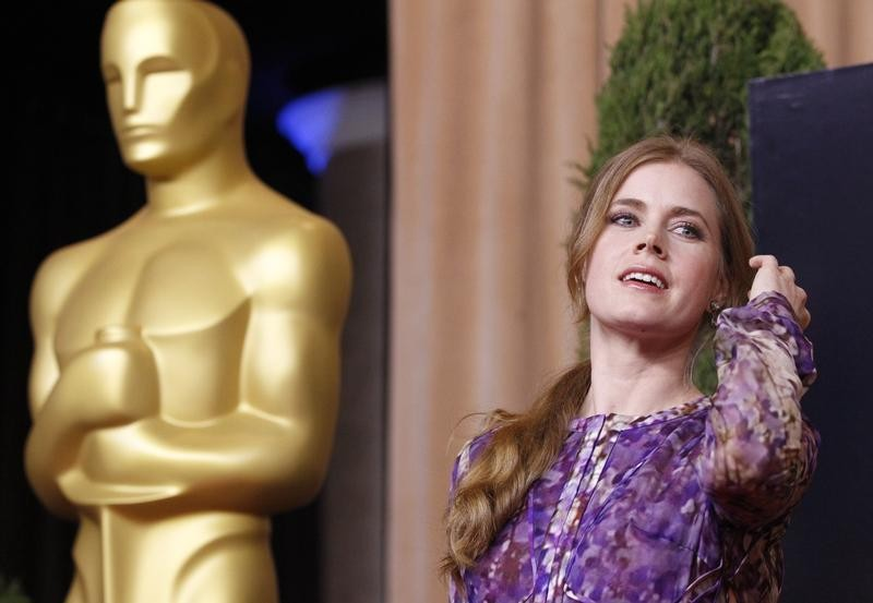 Amy Adams, nominated for best supporting actress for her role in The Master, poses  at the 85th Academy Awards nominees luncheon in Beverly Hills, California