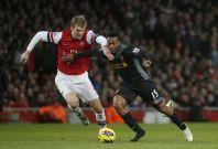 Daniel Sturridge battles Arsenal's Per Mertesacker